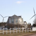 A beautiful home in West Cape PEI with the West Cape Wind Farm in the background. Islanders get an average of 26 per cent of their electricity from wind power. Virtually all of the rest comes from an inter-tie undersea cable to the New Brunswick grid. Photo David Dodge, GreenEnergyFutures.ca