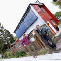 Homeowner Corelius Koster and Tom Jackman of Simple Solar in front of the net-positive garage suite in Ramsay neighbourhood of Calgary, Alberta. Photo David Dodge, GreenEnergyFutures.ca
