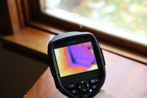 *An infrared camera helps find air leaks and places in your home where heat and money are literally going out the window! Photo David Dodge.