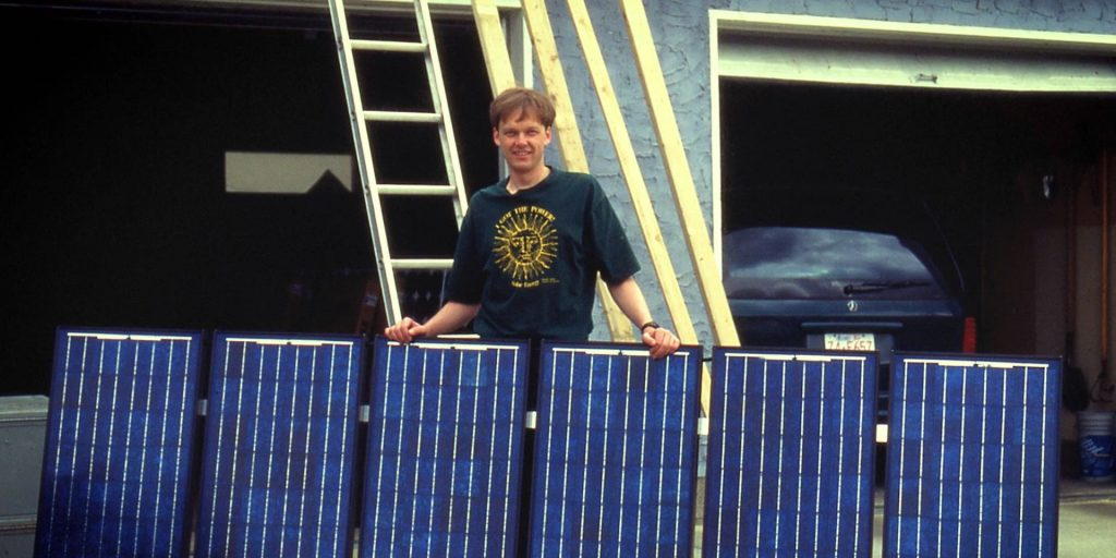 Gordon Howell installing first solar system